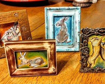 Four mini framed rabbits set