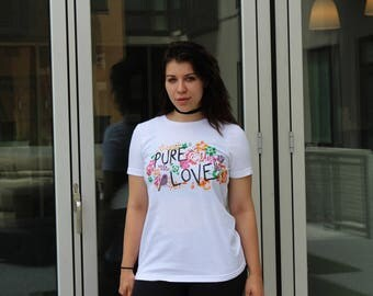 """White T-Shirt with """"Pure Love"""" written on it"""