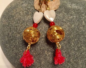 gold plated earrings with mother of Pearl Heart