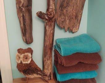 Handmade wall shelf made with cedar shelves and driftwood accents.