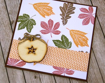 Autumn card with wooden apple