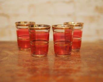 Four Vintage Pink and Gold Shot Glasses