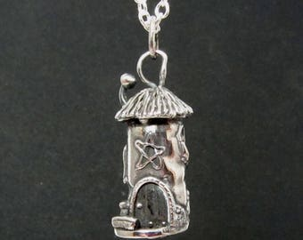 A detailed handmade silver pendant