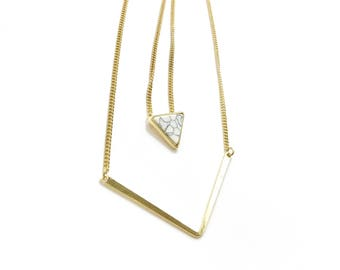 Arrow and triangle white marble pendant necklace. unique and gorgeous.