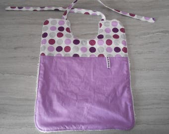 Purple cotton baby bib and white cotton towel