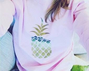 Baby pink sweatshirt with gold pineapple print