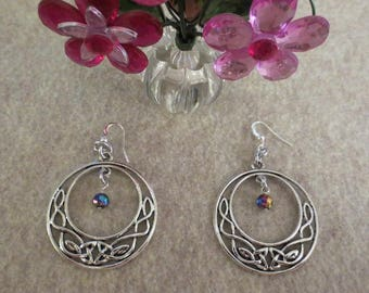 Pretty Silver round decorated dangle earrings