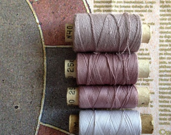 Spools of threads set. Vintage organic cotton 4 threads spools in lilac colors.