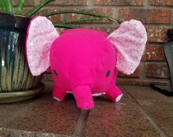 Pink elephant stuffed animal with pink and white star printaccent