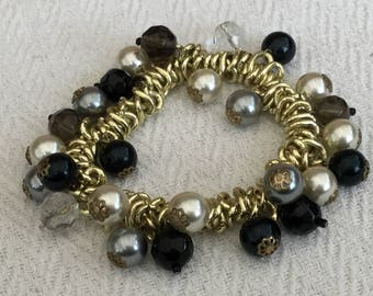 Golden switts, Faceted And Pearls Glass Bead Elasticated Bracelet