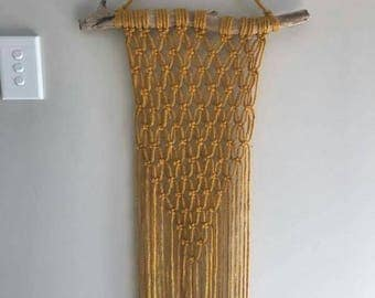 Boho Macrame Wallhanging on driftwood in a mustard acrylic yarn