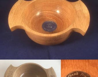 A hand-turned oak quaich with an engraved silver base