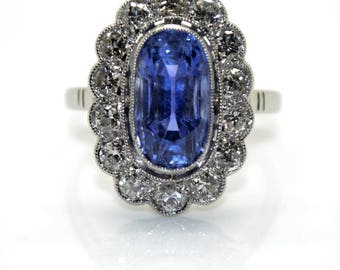Surrounding Sapphire and diamond ring