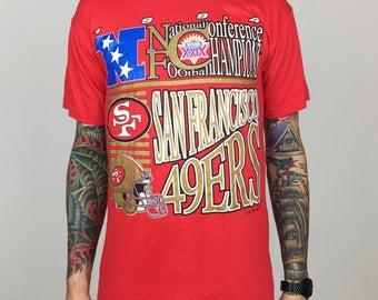 Vintage 90s 1994 94 NFL San Francisco 49ers '94 NFC Champs Champions metallic print football graphic tee t-shirt shirt - Size M
