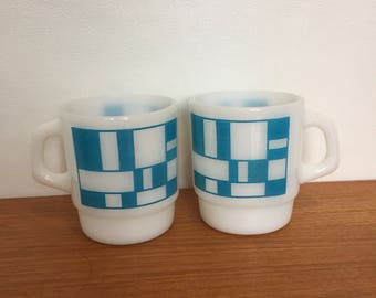 Two blue & white mid century Anchor Hocking Fire-king mugs