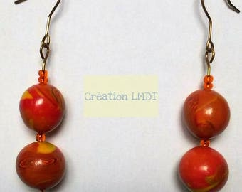 Dangling earrings with shades of orange beads