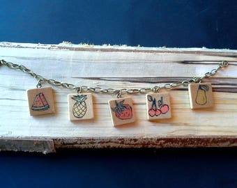 Vintage scrabble tile charm bracelet, hand drawn and woodburned fruit charms, Red, green and yellow, reverse side says SWEET