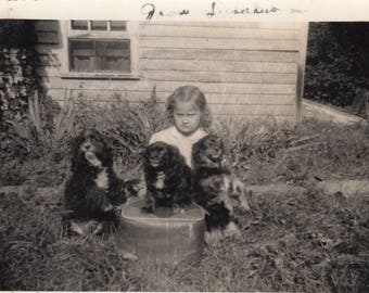 Vintage Adorable Photo Little Girl Playing With Puppy Dog Friends Black & White Found Antique Art Ephemera Snapshot Paper Design Old Decor