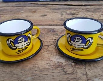 Cups and saucers advertising enamelware (MICHELIN)