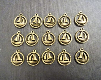 15 BRONZE SAIL BOAT nautical charms - measures 3/4 inch in diameter - jewelry making or party favor charms