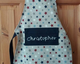 Star Apron with pocket, available in toddler, children's and adult sizes. Can be personalised
