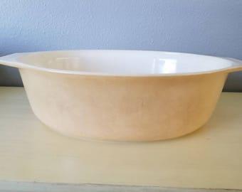 Pyrex tan casserole dish
