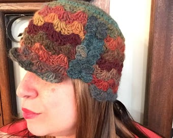 Wool Cloche celebrating the Autumn colors with Greens, Oranges, opening and quirky fun  flower petals