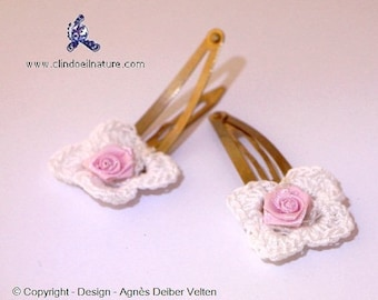 Hair pins. Adorable little crocheted flowers mounted on hair clips