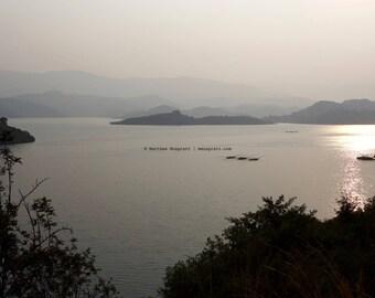 Lake Kivu, Rwanda, East Africa • Fishing fleet returns home at dawn • Landscape photograph printed on canvas