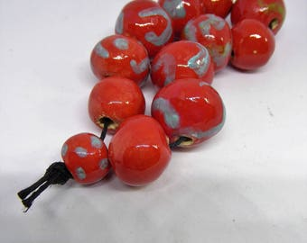 Artisan made ceramic beads - set of 12 - Red with some blue and some green