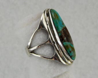 Silver and turquoise knuckle ring.