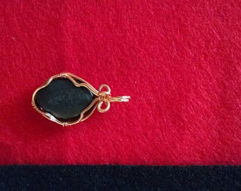 black slate stone with delicate copper wire wrapping