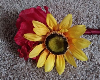 Sunflower and burgundy rose boutineers