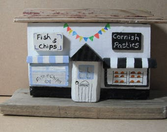 Cornish pasty shop and fish and chip shop made from driftwood collected from Solent beaches.