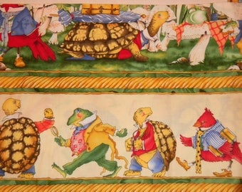 Woodsy Wonder by MM Fab.  This is a horizontal design similar to a border print.  It features frogs, turtles, and red birds.