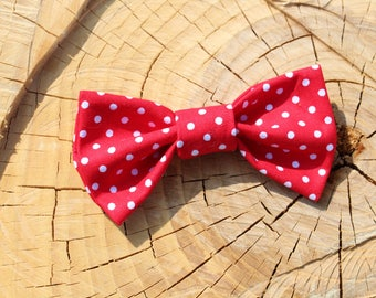 Red Polka Dotted Fabric Bow on a one size fits all Nylon Band