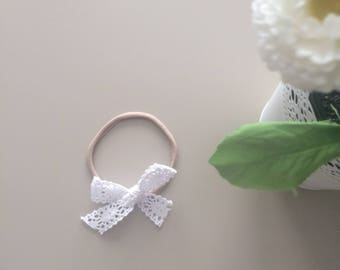 Lace bow on one size fits most nylon headband
