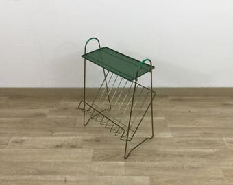 Magazine rack and vintage green disc