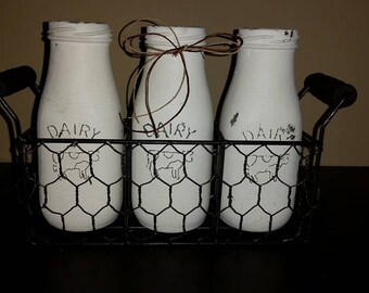 RESERVED FOR DENISE S.Milk Bottle Candle Set of 3 in wire basket with wood handles, Snickerdoodle scent, bottles painted white distressed