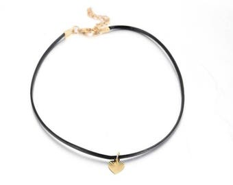 Black leather choker with gold heart pendant