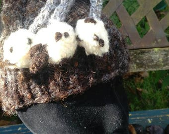 Three flying sheep woolly hat. A very warm wool beanie with 3 white sheep dangling from the top. Handspun, hand knitted and unique.