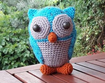 Ollie, the lucky owl. Handmade knitted stuffed animal.