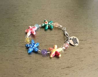 Child starfish bracelet with adjustible lenght and lobster claw clasp