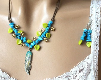 Ships blue olivine green leaves and feather adornment