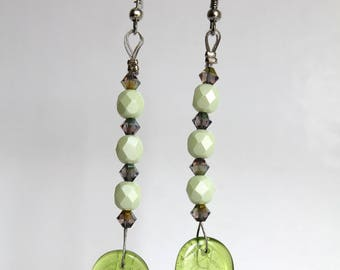 Long leaf earrings and pastel green facets