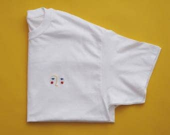 Medium hand embroidered primary face on white t-shirt