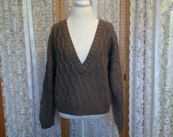 Gently used wool blend v-neck , baby cable pullover in taupe. Size M.