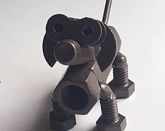 Welded dog nuts and bolts sculpture art