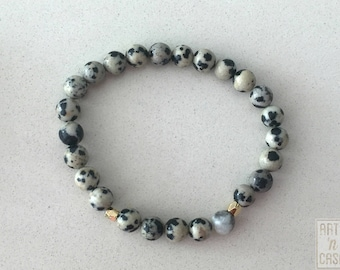 Bracelet with Dalmatian Jasper beads and Golden parts