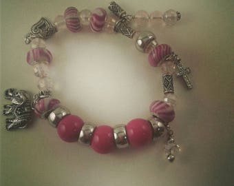 Charming Charm bracelet, pink, silver and crystal beads, on stretchy cording